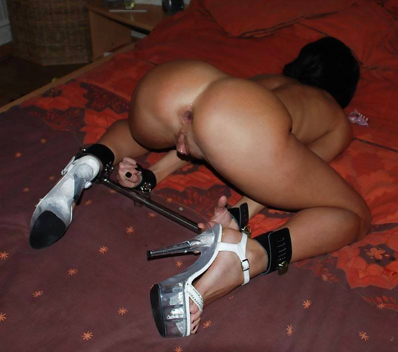 High heel spreader bar bondage
