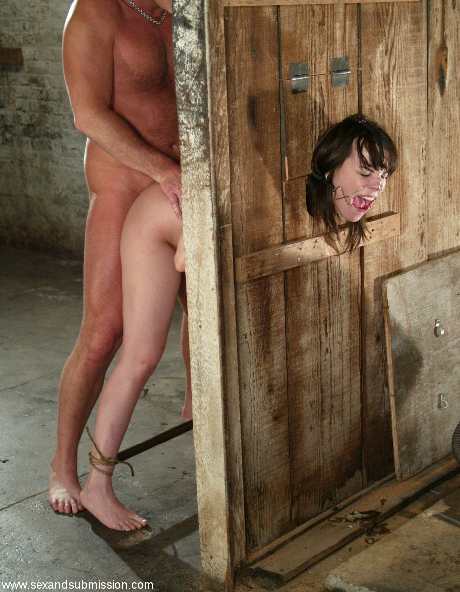 image Sexy bdsm victim with perky tits gets whipped in the sex dungeon