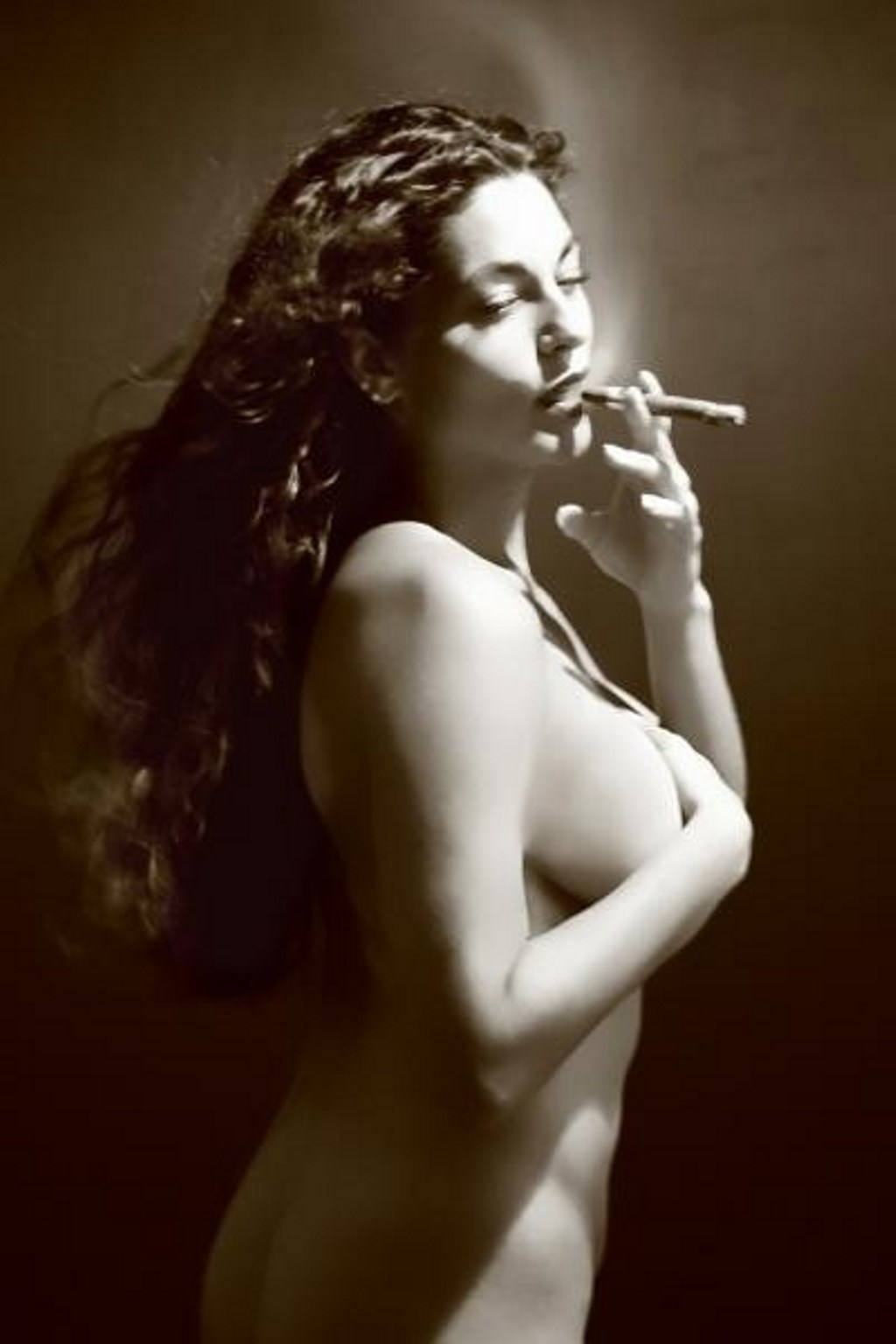 Naked Woman Smoking A Cigarette Behind The Window
