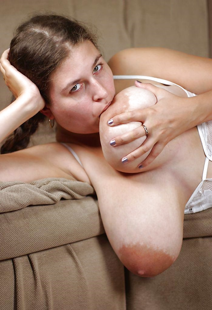 Girl sucking her own nipples