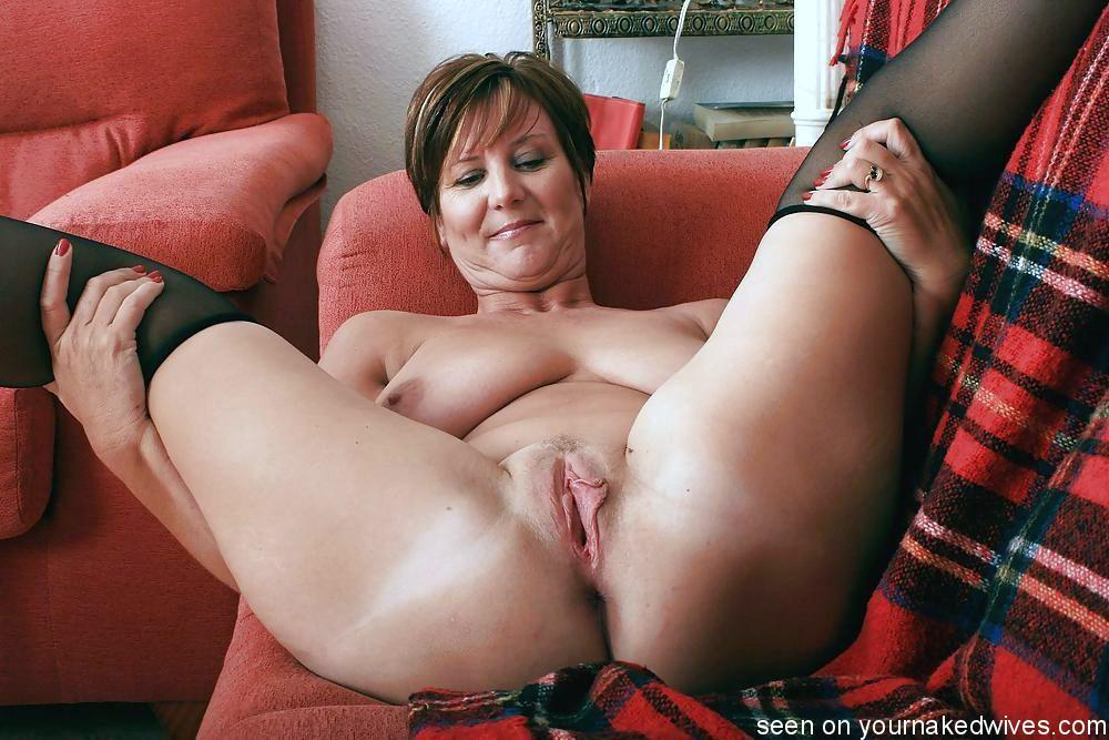 Naked mature women with legs spread attentively