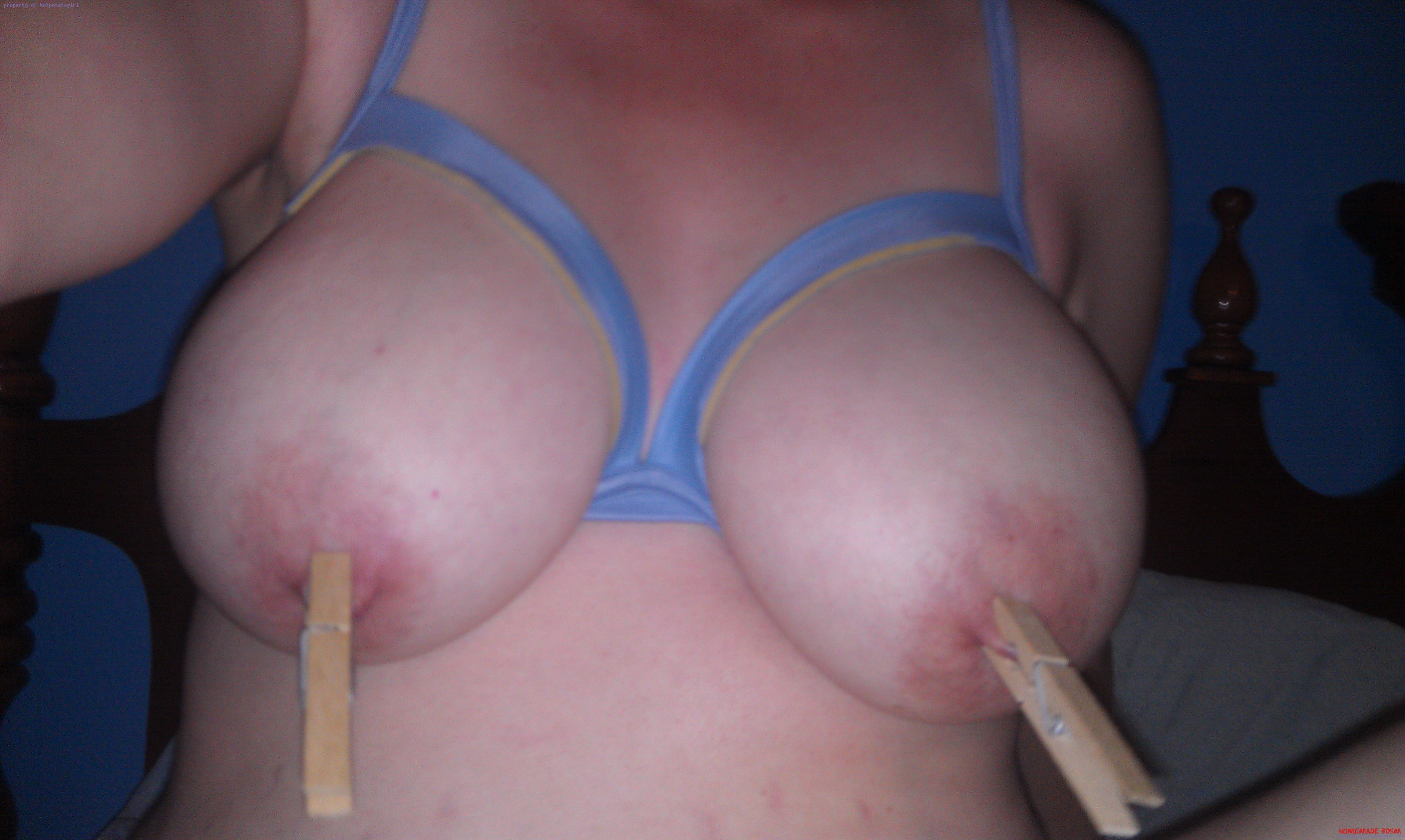 Womans tits with clothespins on nipples