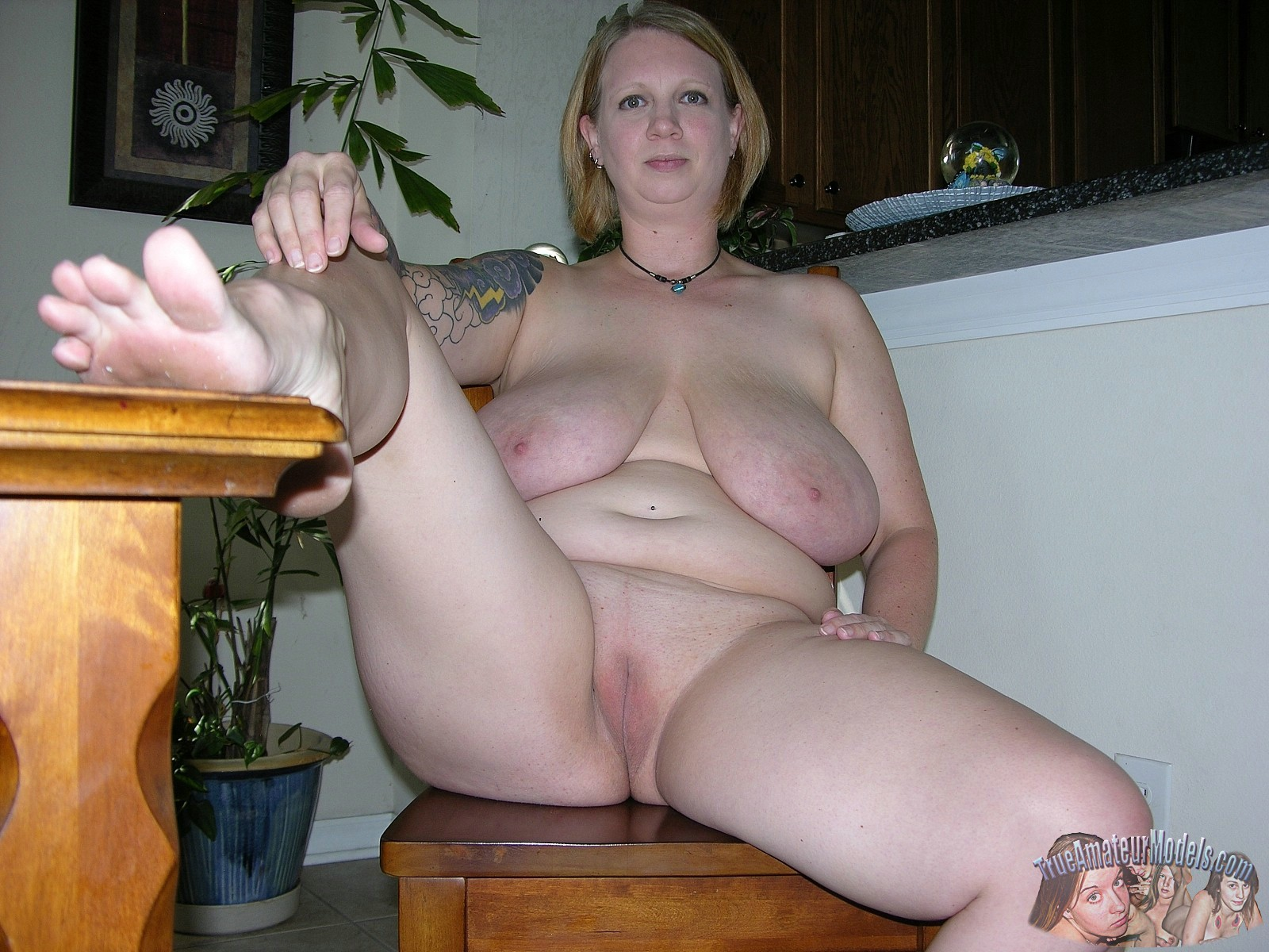 Girl sitting on couch nude