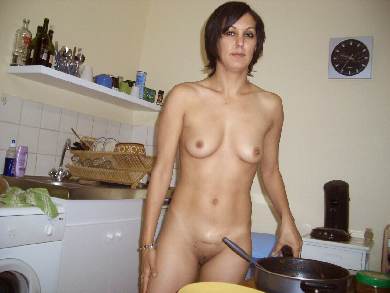 Kitchen naked housewife in