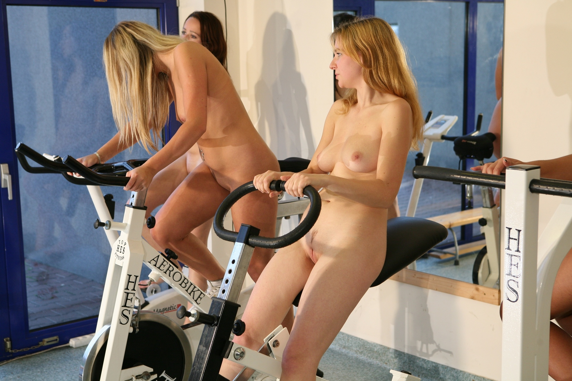 Girls working out topless