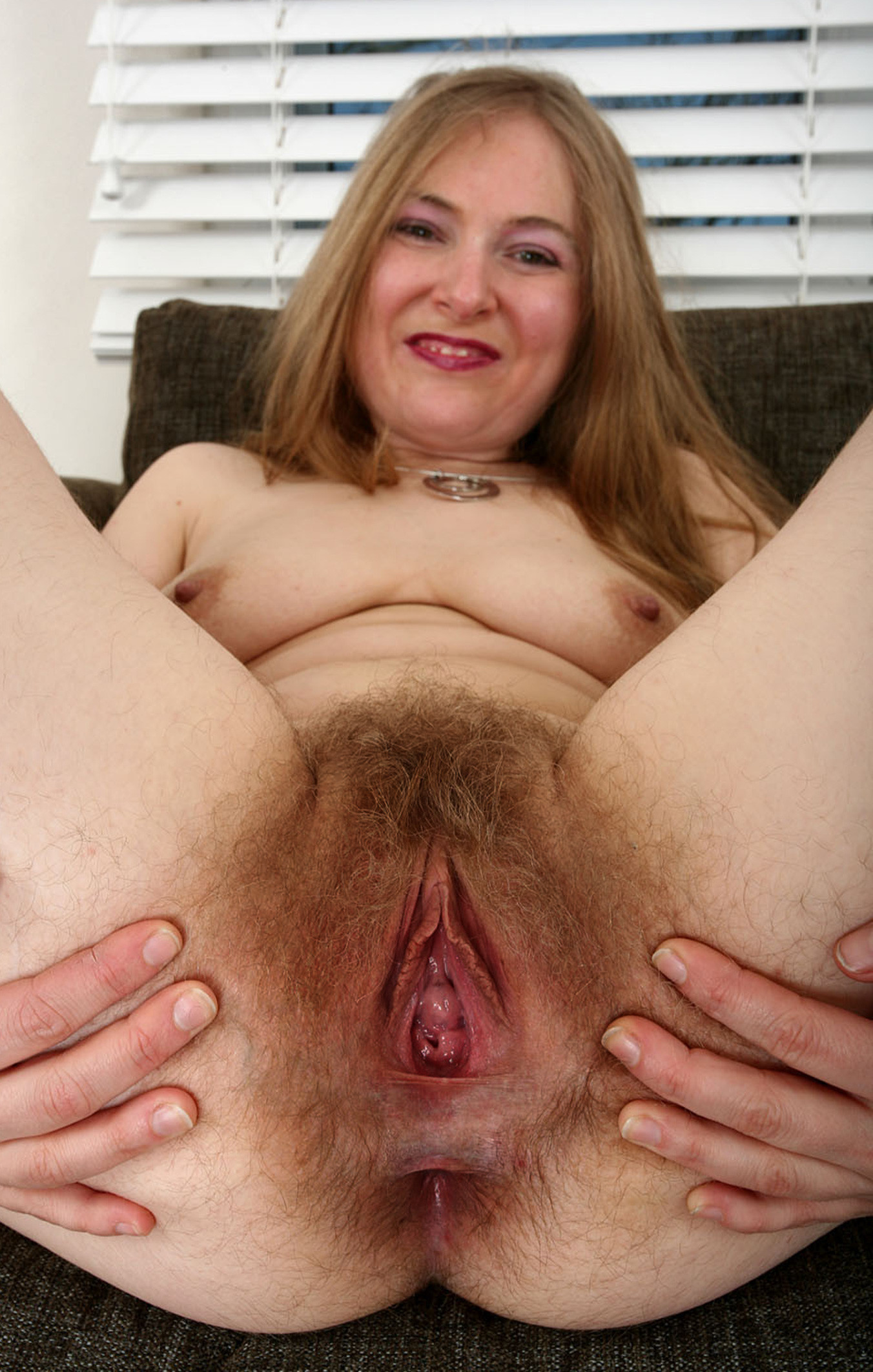 Mature pussy spread wide