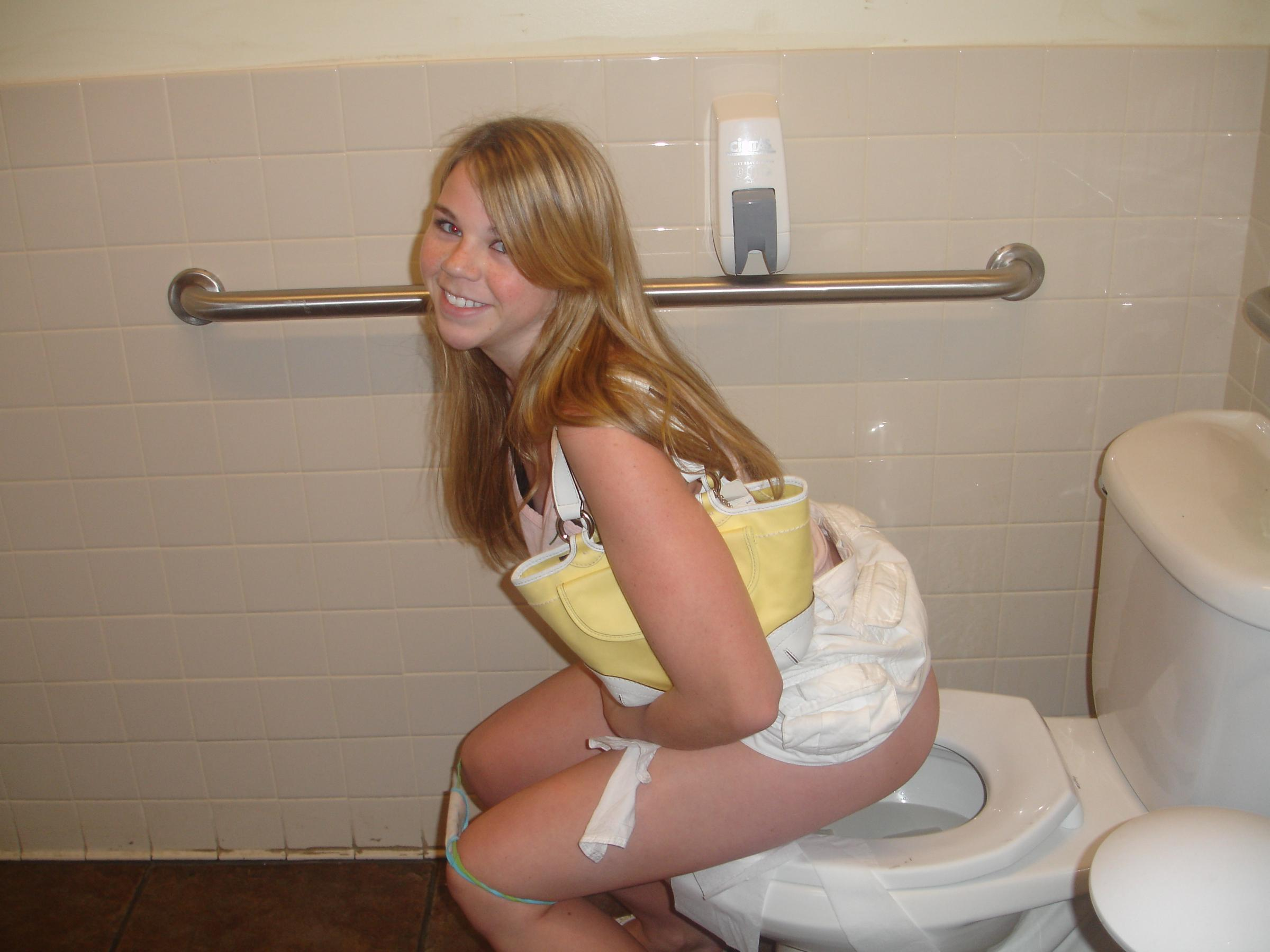Toilet girl peeing in