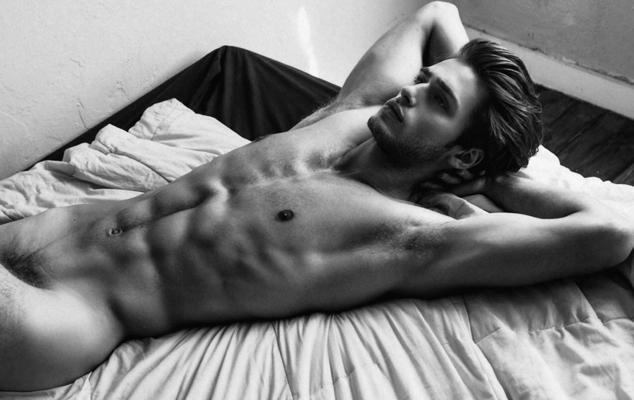Naked fit man on bed