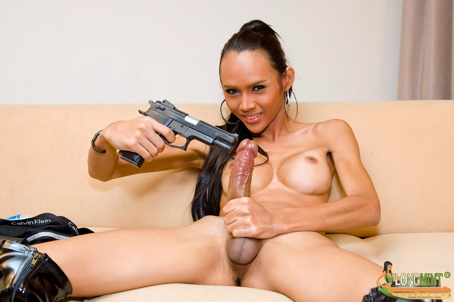 Girl masturbates with gun porn
