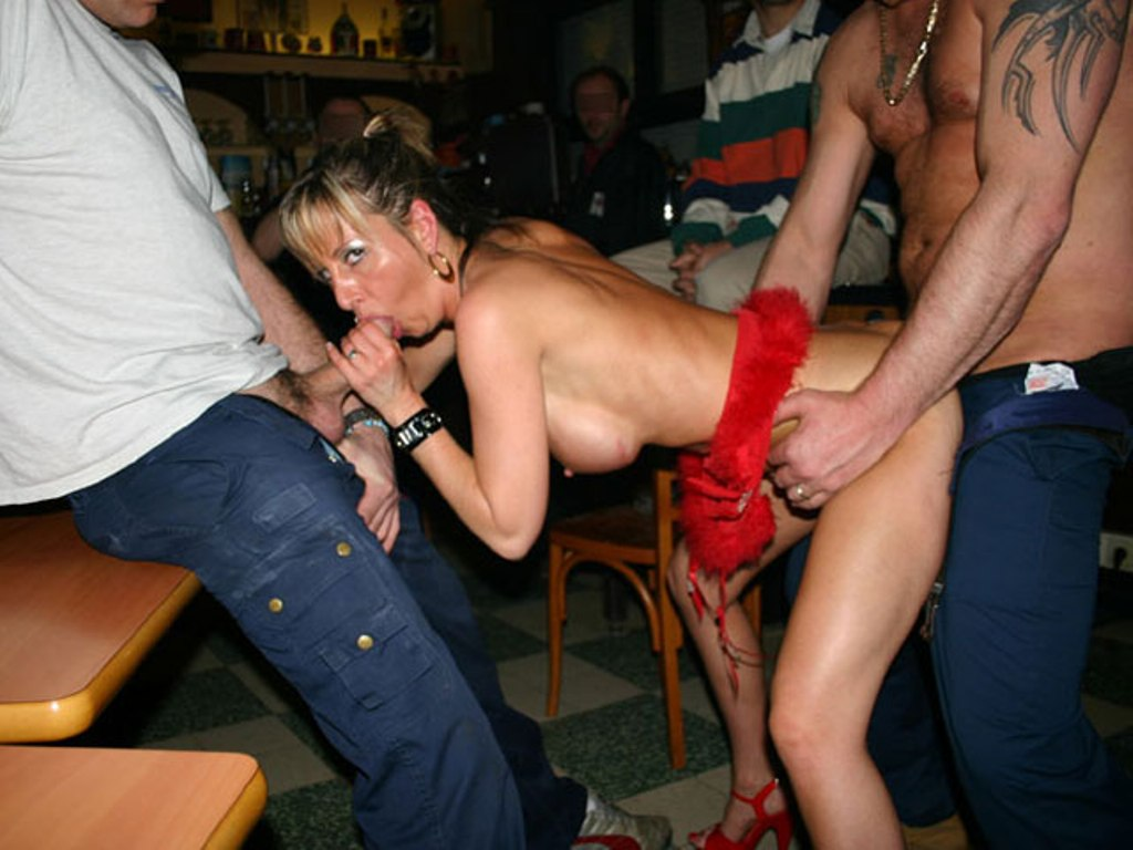 Anal gangbang and pussy lick in public bar sex photo