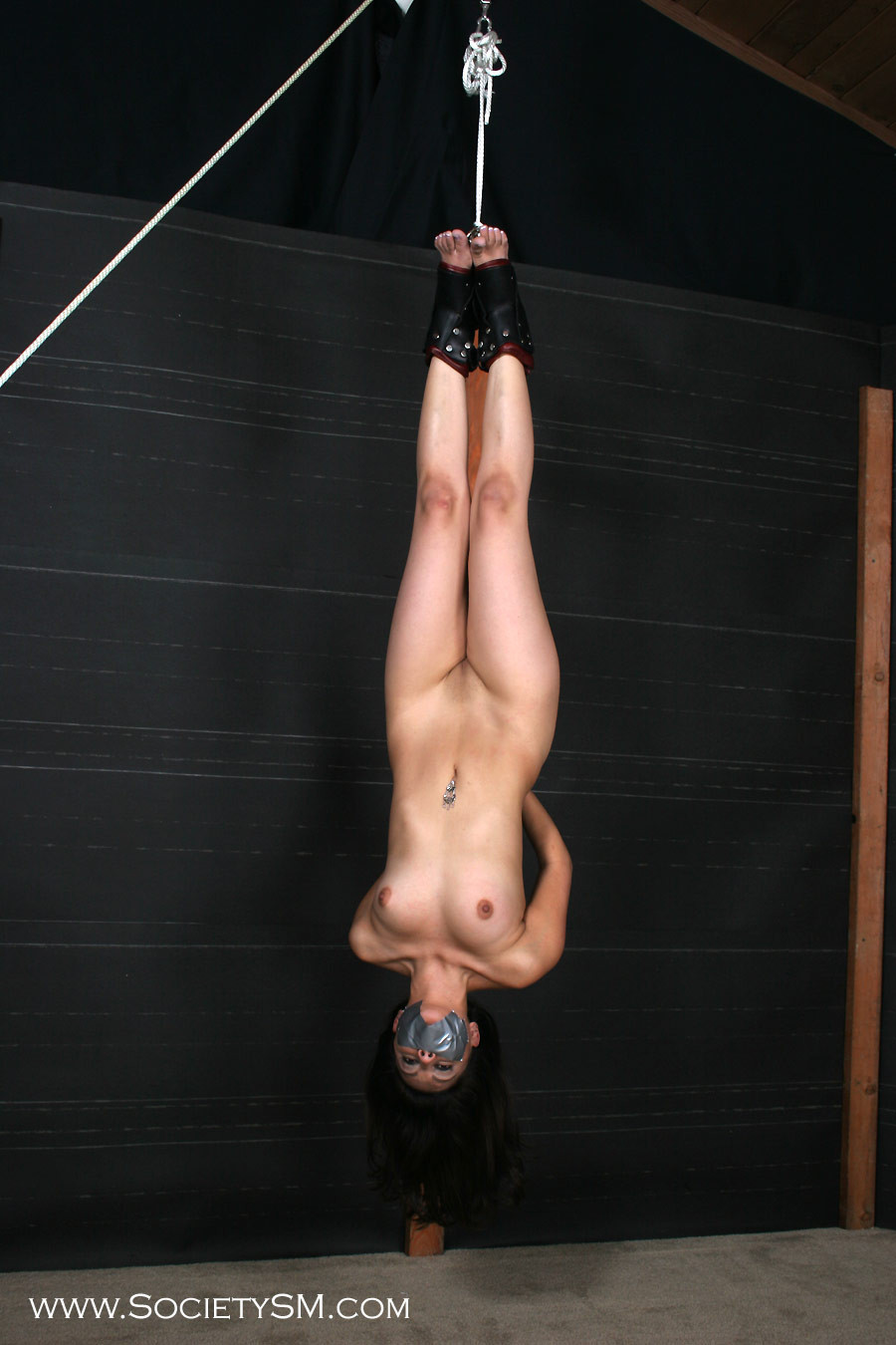 Naked super girl hung upside down 6