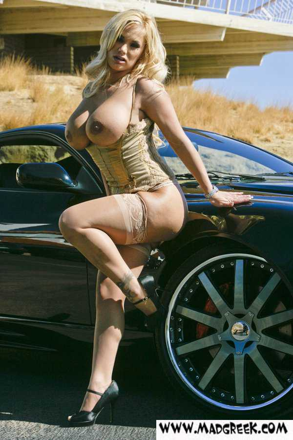 Classy Hot Blonde Chick From Canada Bares Her Knockers Over Sports Car Pictures 1