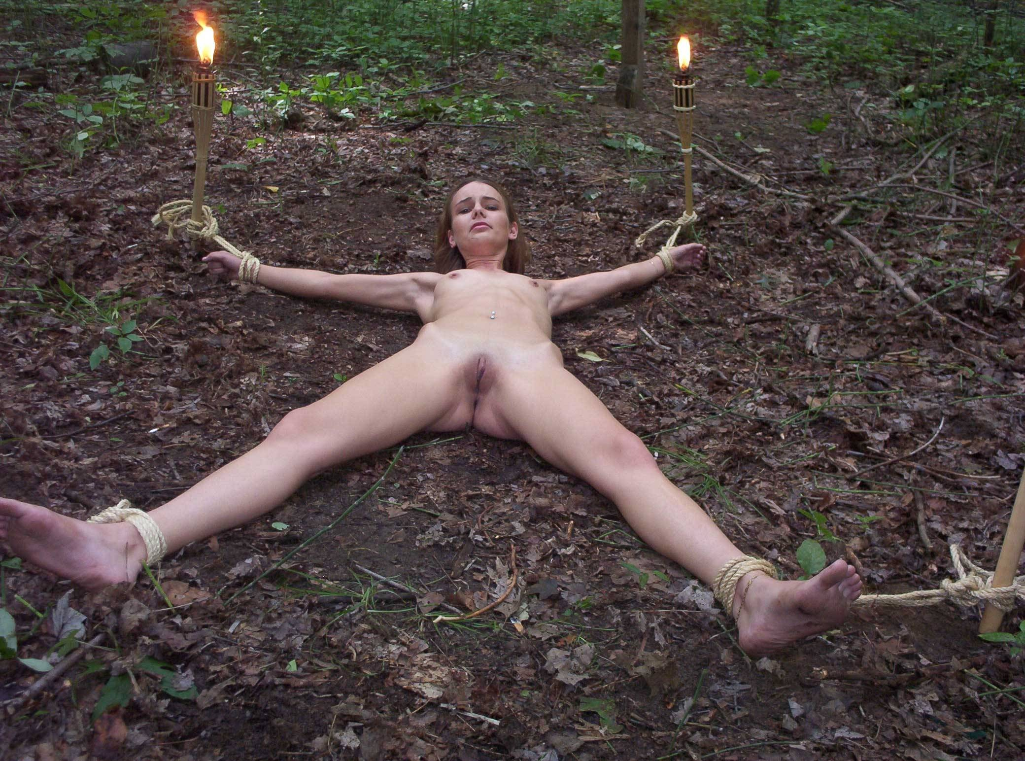 Naked slave in the forest sex video