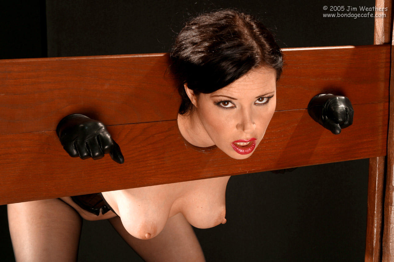 Delightful naked woman in the pillory assured