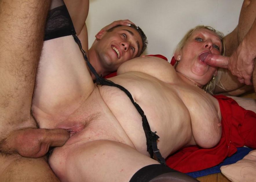 Big breasted mature slut dicked by two guys