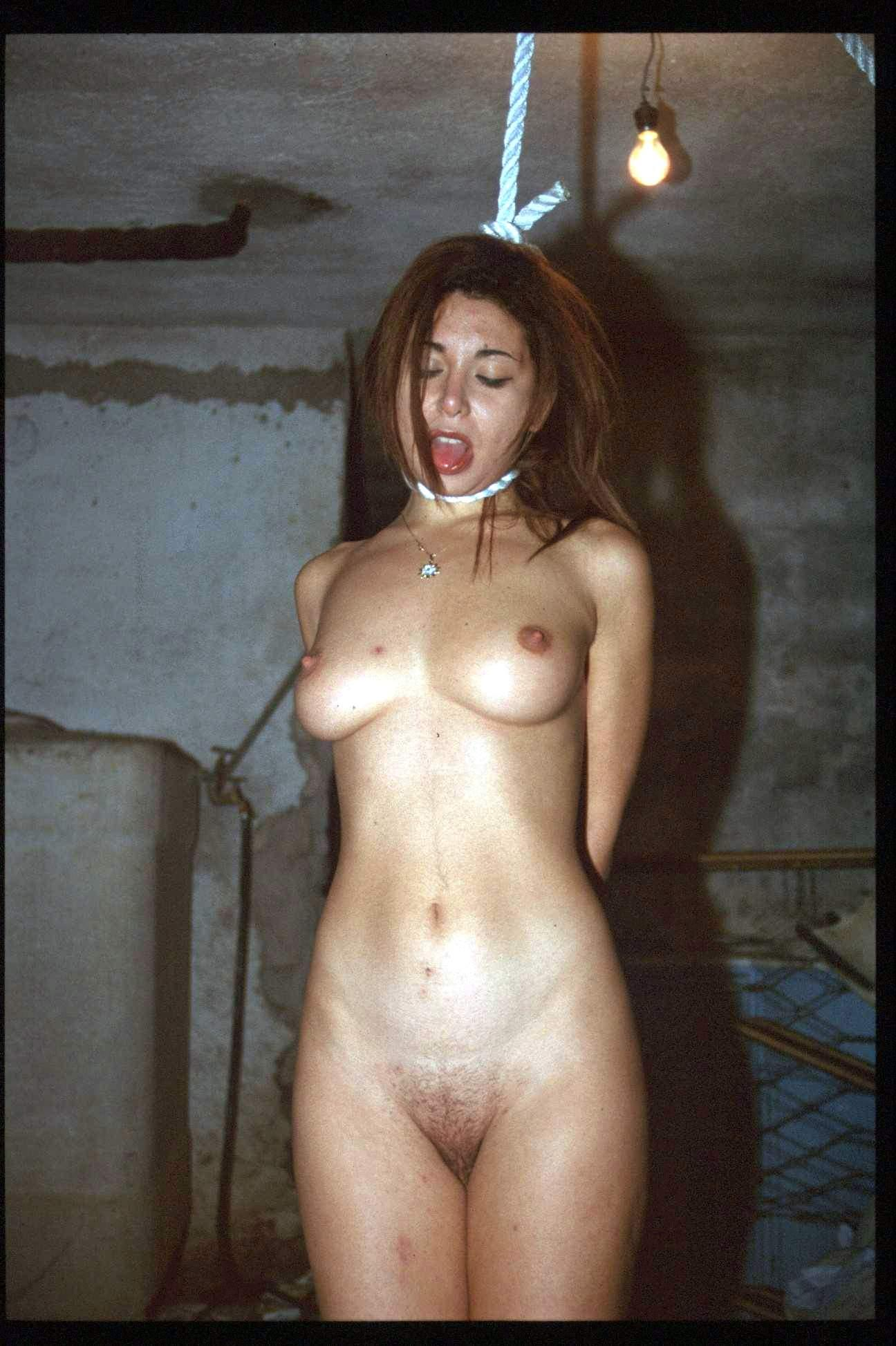 Naked girl hanging by neck