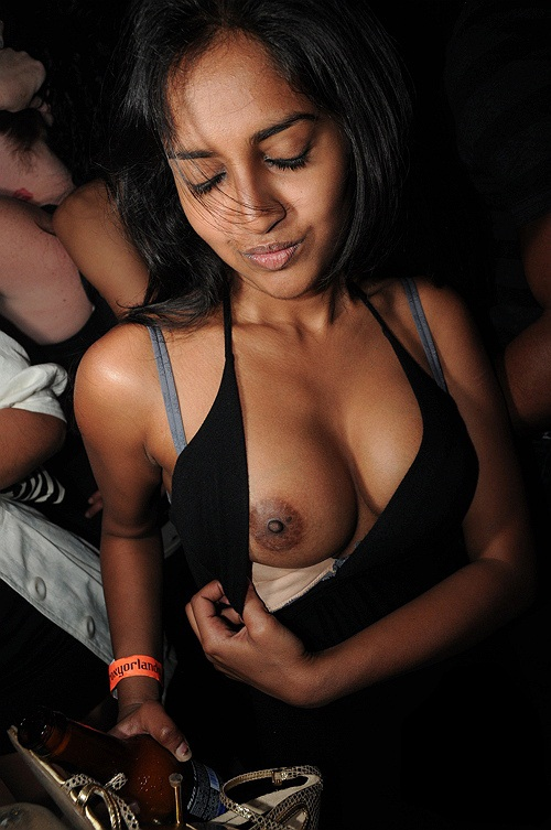 Hot club girl flashes tits