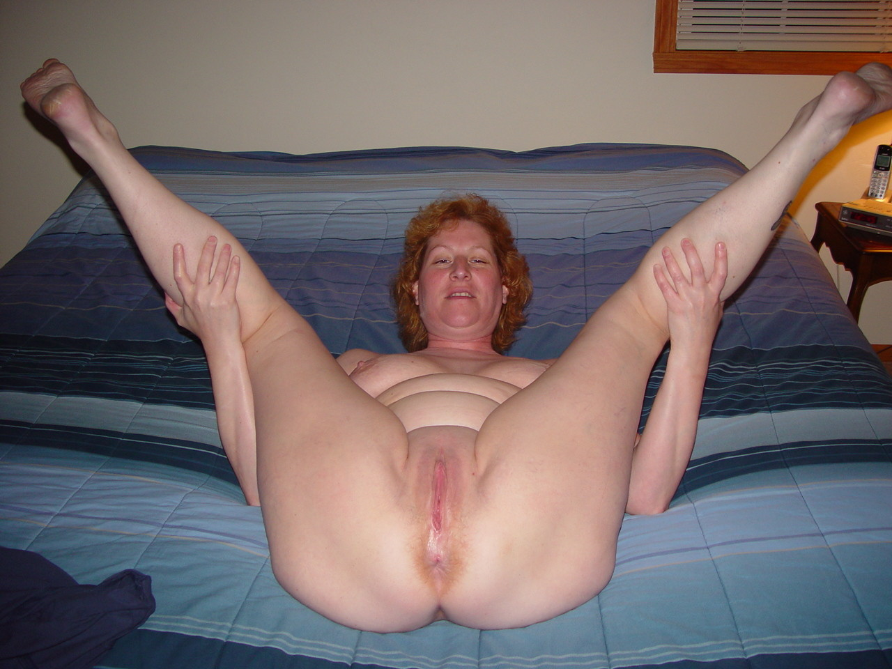 She smiles wide as a cock enters her ass