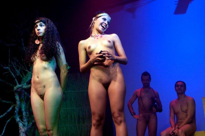 Three topless girls on stage