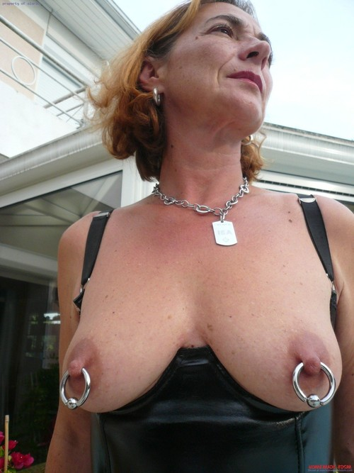 image Heavy pierced milf slave with lots pussy rings dominated