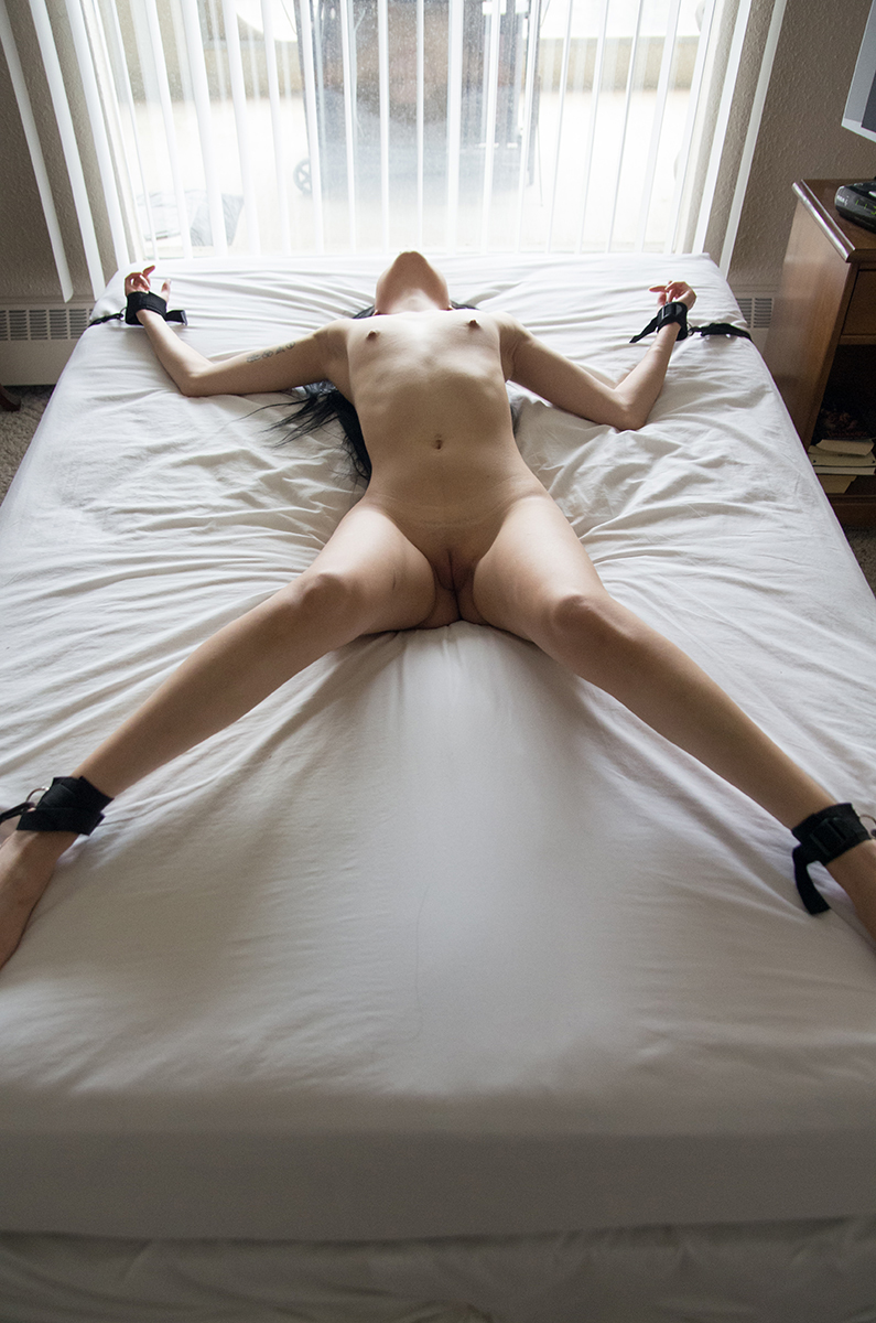 tied nude bed