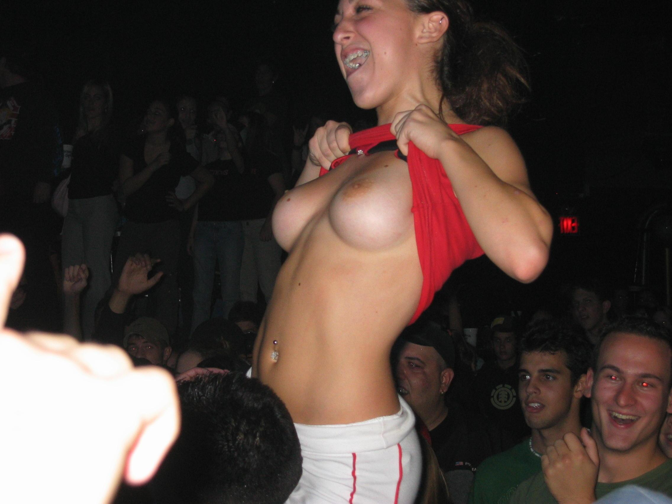 Girls flash at concert