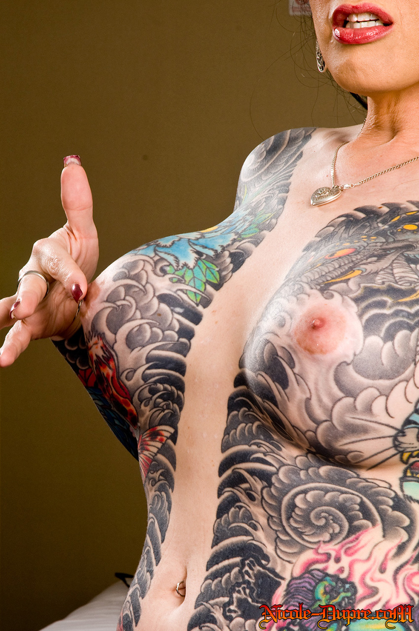 Nude women with tattooed breasts — photo 3