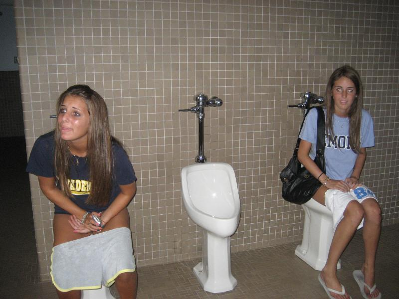 Girls pissing in urinals