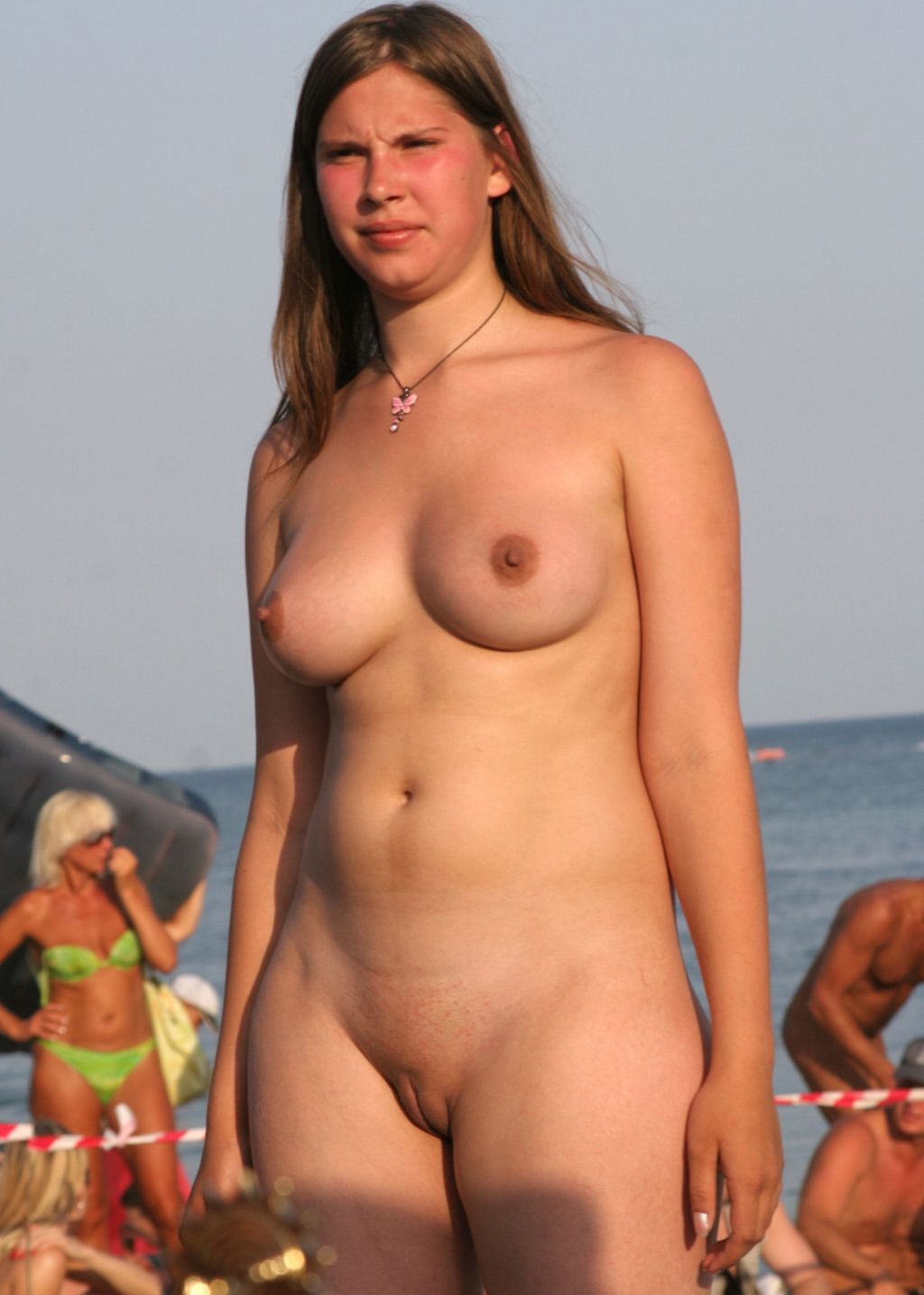 Young lady on nude beach, senior citizen nudes