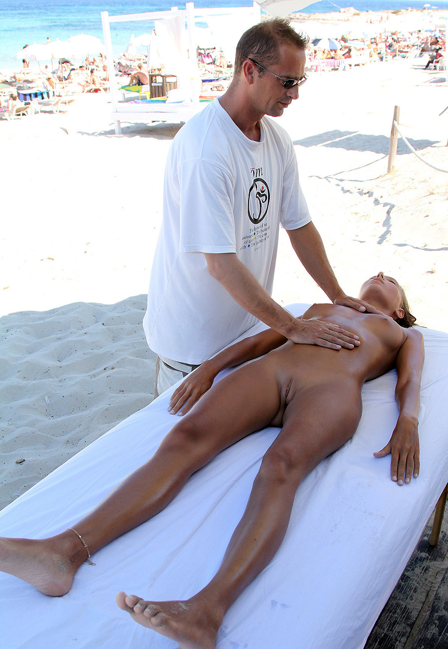 Young wife in the beach club massage