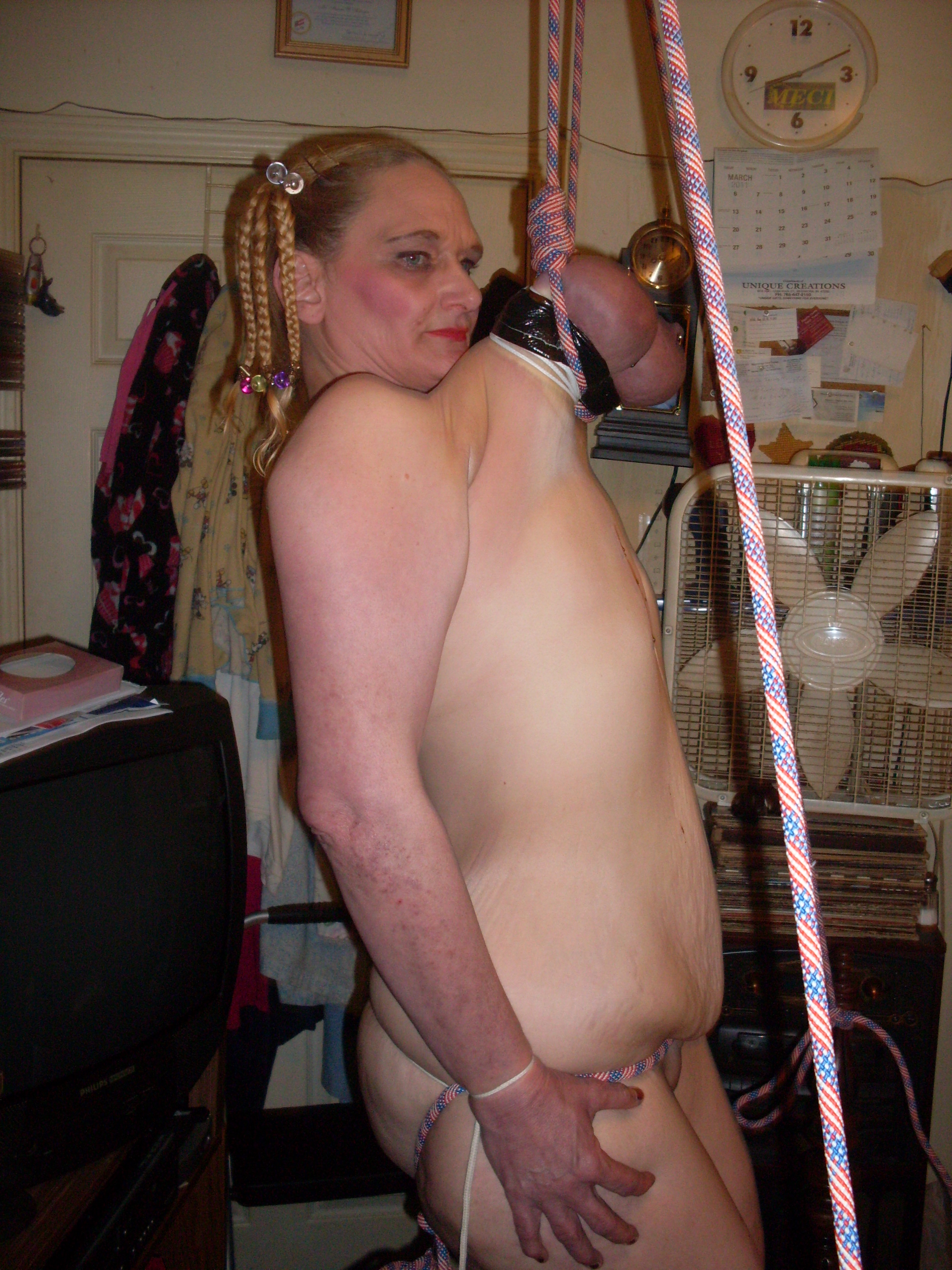 Woman hung by her tits