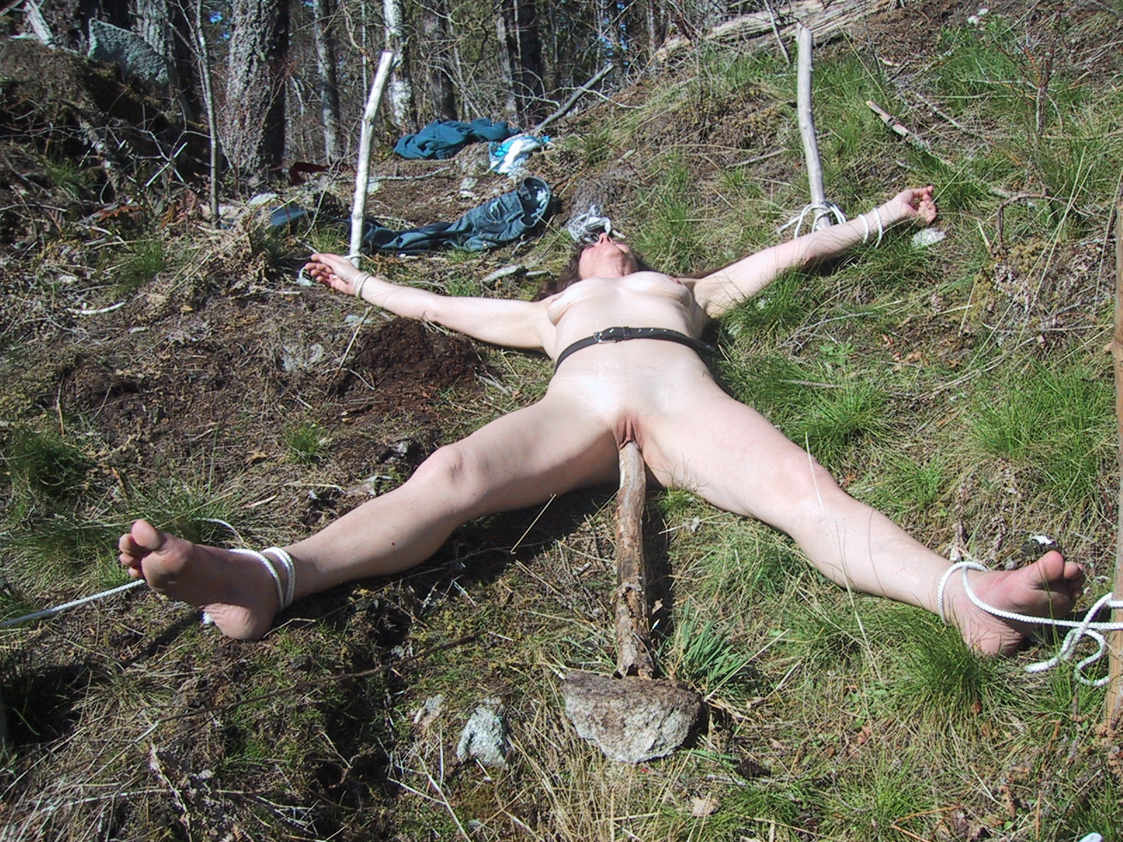 Women doing striptease outdoors