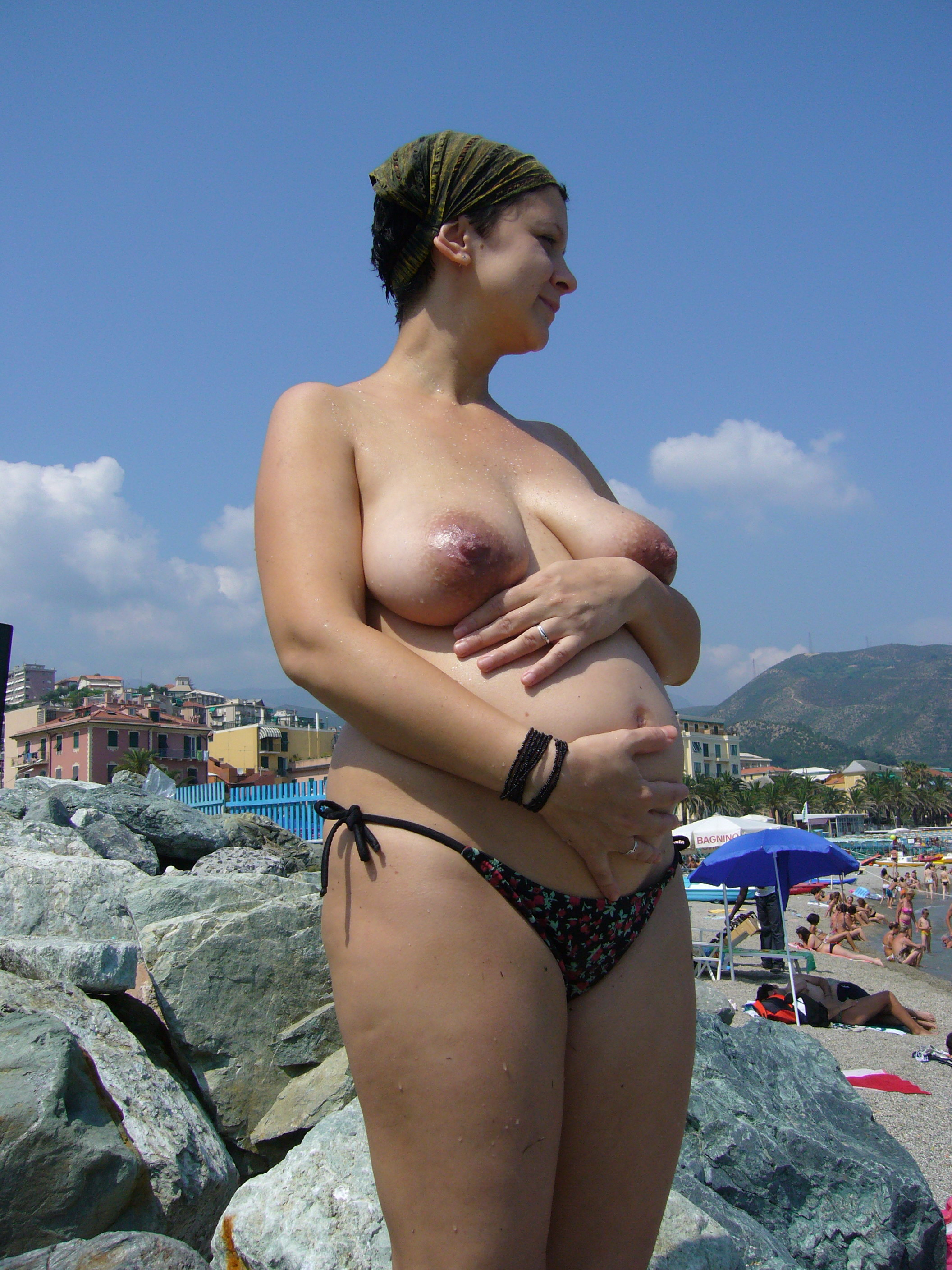 Pregnant naked girls in beach