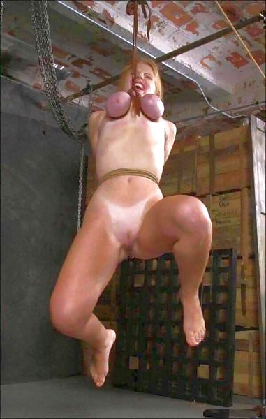 Bdsm picture hung by her tits