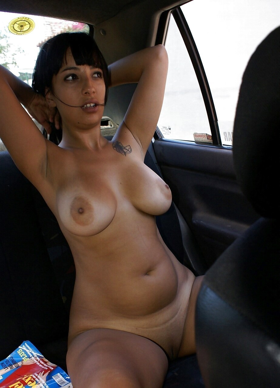 Nude girl in backseat of car