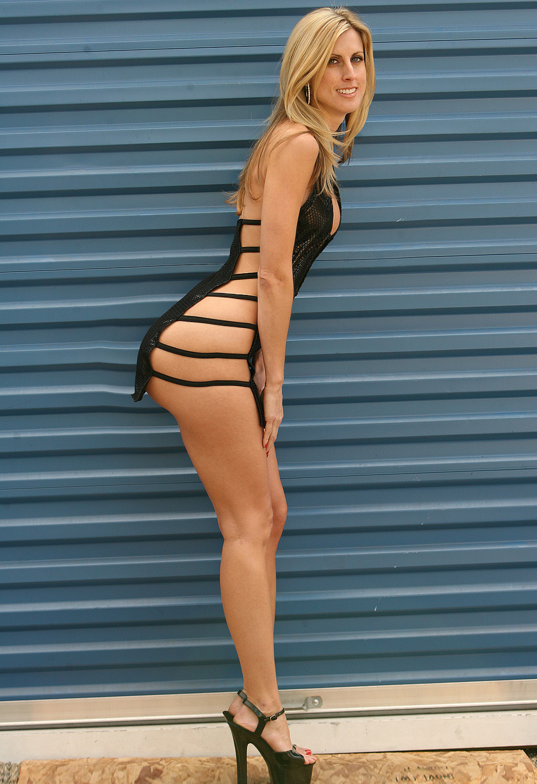 Blonde milf in dress teasing